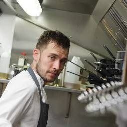 chef stood in kitchen